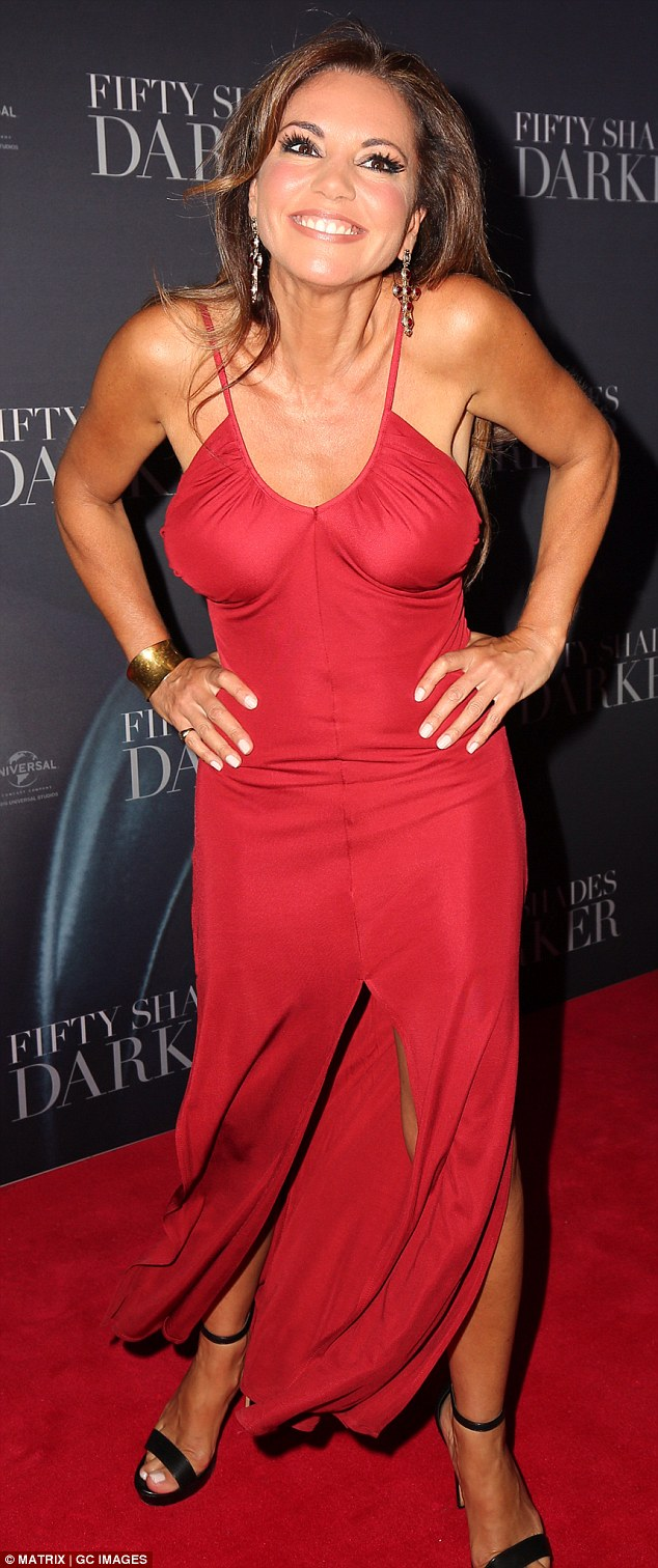 Ravishing red! A bubbly Susie wore a red maxi dress which showed off her ample cleavage and lithe figure