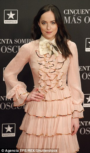 Vintage: The actress put on a classy display in a pale pink Victorian-inspired dress with a skirt which boasted tiered ruffless