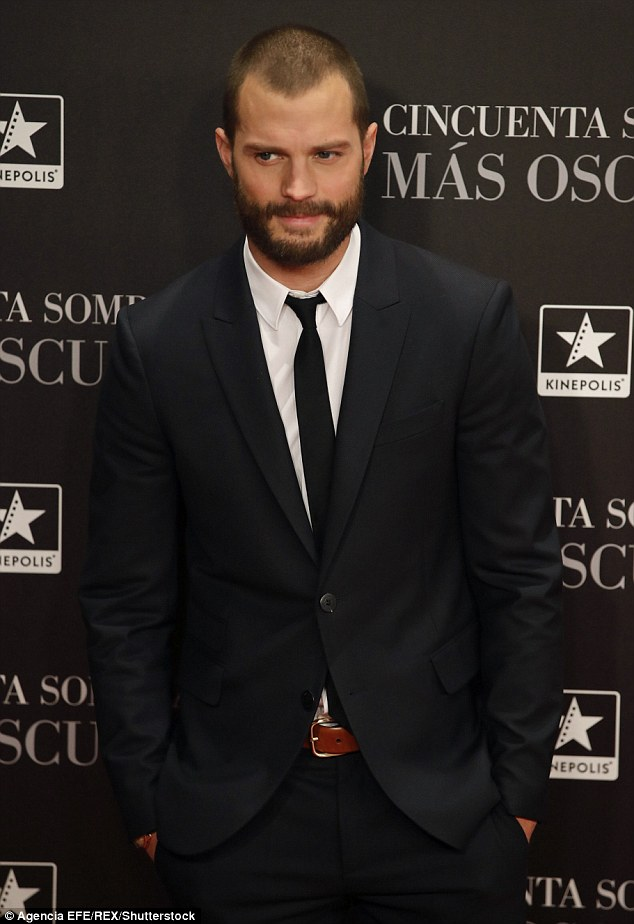 Rugged: Jamie sported a well-groomed beard and looked relaxed with his hands in his pockets