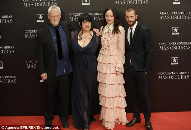 Teamwork: Joining her on the red carpet was co-star Jamie Dornan, director James Foley and writer E.L. James