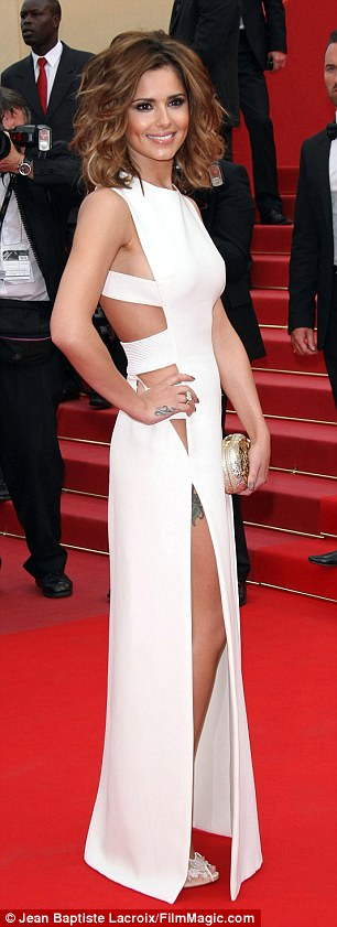 White hot: For her first big look in 2010, she stunned in a sexy cut-out white gown, (L) before going on to take the plunge with one of her most recognisable red carpet looks the following year